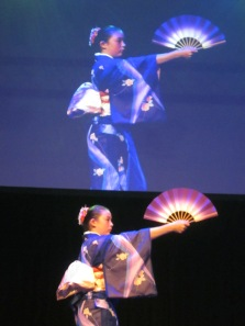 Traditional dance with a hand fan in Kimono